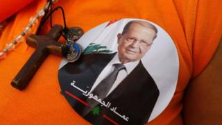 A supporter of Michel Aoun's Free Patriotic Movement dressed in orange in Jdeidah, Lebanon (31 October 2016)