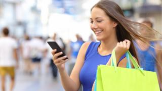 Young woman shopping with mobile phone