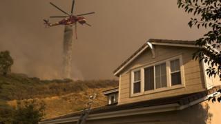 Helicopter dumps water near Santa Clarita, California
