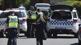 Police attend the scene at Meadow Heights in Melbourne, Australia, where a house was raided in connection with an alleged terror plot, 23 December 2016