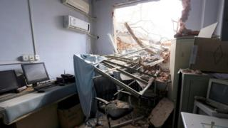 In this Thursday, Jan. 7, 2016 photo, rubble and debris spills into a room at the No. 4 Hospital of Zhengzhou University after the demolition
