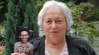 Olga Weisfeiler shows a picture of her brother Boris