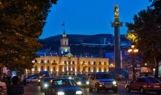 Traffic in front of Tbilisi city hall at night