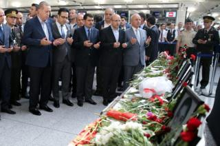 Turkish President Recep Tayyip Erdogan (left) praying at Ataturk airport, 2 July 16
