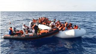 Members of Maltese NGO MOAS help people to board a small rescue boat during a rescue operation of migrants and refugees on 3 November 2016, off the Libyan coast in the Mediterranean Sea.