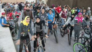 Girls and boys on their bikes during the ride in Port Said
