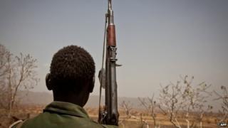 Rebel soldier looks out toward Talodi, in South Kordofan