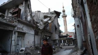 A Syrian boy walks through rebel-held Douma, near Damascus (9 January 2017)