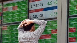 Man watching Japanese stocks