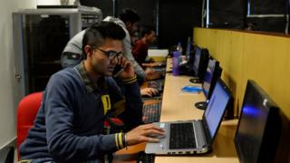 In this photograph taken on December 13, 2016, an employee of Indian IT security solutions company Innefu Labs works at their offices in New Delhi