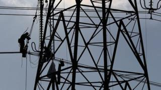 Workers on electricity pylon