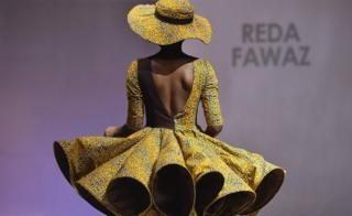 A model presents a creation by label Reda Fawaz during a fashion show marking the 170th anniversary of Dutch manufacturer Vlisco in Abidjan, Ivory Coast - Saturday 26 November 2016