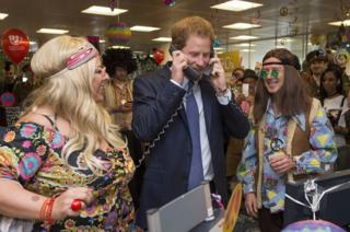 Britain's Prince Harry mans the phones at the 24th annual ICAP Charity Day at the offices of ICAP brokers in central London