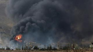 Smoke rises from what activists said was a military position of forces loyal to Syria's President Bashar al-Assad after clashes with Army of Islam fighters near the town of Douma (13 September 2015)