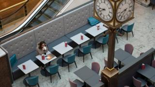 Woman drinking coffee in Trafford Centre