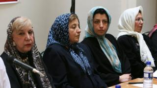 """Prominent Iranian human rights activist Narges Mohammadi, second right, sits next to Iranian Nobel Peace Prize laureate Shirin Ebadi, second left, and the now deceased poet Simin Behbahani, left, while attending a meeting on women""""s rights in Tehran, Iran on 27 August 2007"""