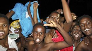 Young men celebrating election