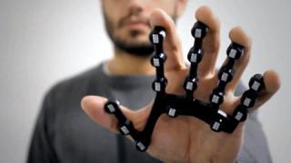 Man wearing digital glove