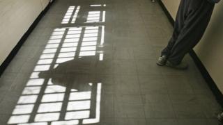 Prisoner looking through a window