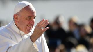 This file photo taken on March 01, 2017 shows Pope Francis waving to the crowd as he arrives for a weekly general audience at St Peters square on March 1, 2017 in Vatican.