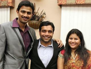 Srinivas Kuchibhotla, left, poses for photo with Alok Madasani and his wife Sunayana Dumala in Cedar Rapids, Iowa.