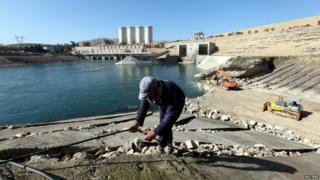 Employees work at strengthening Mosul Dam, northern Iraq, 3 February