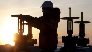 Man operates oil pipeline