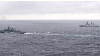 HMS Duncan (right) tracking a warship in the Russian taskforce