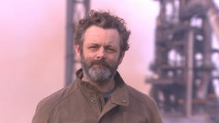 Michael Sheen with Port Talbot steelworks in the background