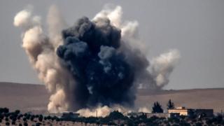 Smoke rises over Jarablus, Syria, 24 August