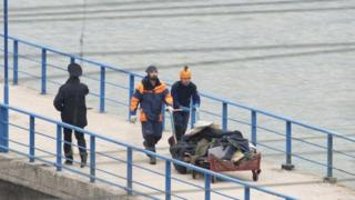 Debris from the plane is returned via a quay in Sochi