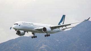 Cathay Pacific to honour $16,000 fares sold for $675 | BBC News