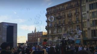 A still from a video of the bubble flash mob