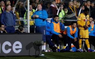 20/2/17: Sutton United's substitute Wayne Shaw eats a pie during the FA Cup match against Arsenal