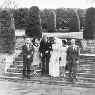 Black and white photo of wedding party