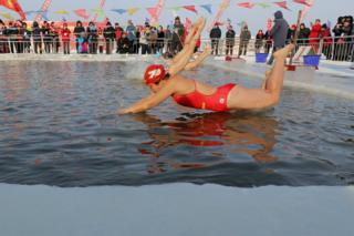 Swimming competition at the Harbin International Ice and Snow Festival