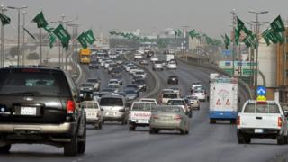 Cars drive down a highway in Riyadh