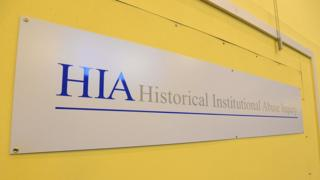 A sign that reads: HIA Historical Institutional Abuse Inquiry