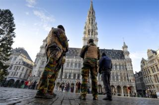 Soldiers and police patrol on Brussels' Grand Place 23 November 2015