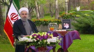 The photo of President Hassan Rouhani with his Haft Seen table