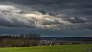 Dark clouds over country landscape