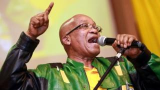 South African President and African National Congress (ANC) President Jacob Zuma leads hundreds of supporters in singing a song during a campaign event at the Inter-fellowship Church in Wentworth township, outside of Durban, on April 9, 2014