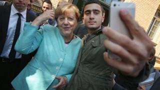Mr Modamani in a selfie with Angela Merkel