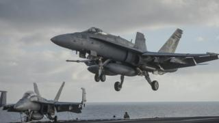 Nuclear-powered aircraft carrier USS Harry S. Truman during a visit by Ukraine's prime minister at at an undisclosed position in the Mediterranean Sea, south of Sicily
