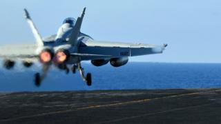 US F/A-18E Super Hornet takes off from the USS Nimitz in the Mediterranean Sea