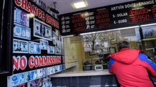 A man changes money at a change office in Istanbul