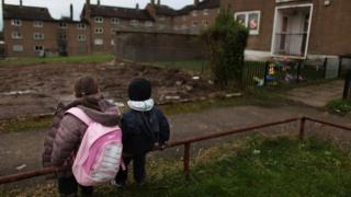 Children make their way home on a housing estate in Scotland