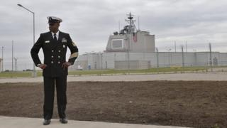 A US Navy officer alongside the AEGIS Command Center building prior to the official inauguration ceremony of the land-based missile defence station (12 May 2016)