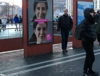 A campaign poster shows Vanja who is Swiss and Vania who is not