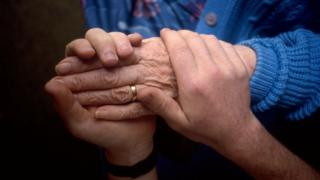 Unpaid carers in England 'struggling'